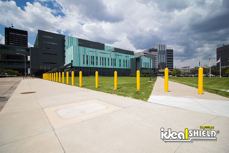 Ideal Shield's Yellow Bollard Covers lining the front of the Detroit Police Headquarters