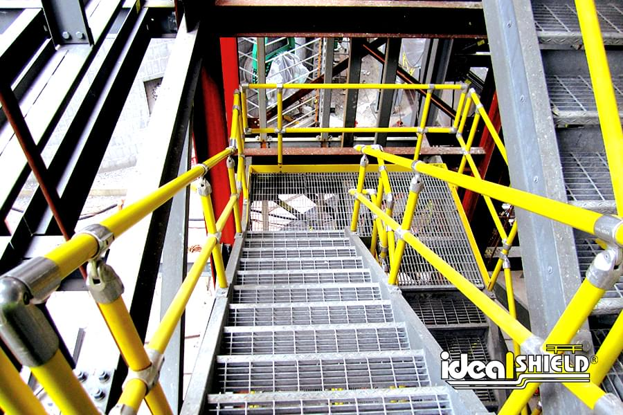 Ideal Shield's yellow Steel Pipe and Plastic handrail down a flight of stairs
