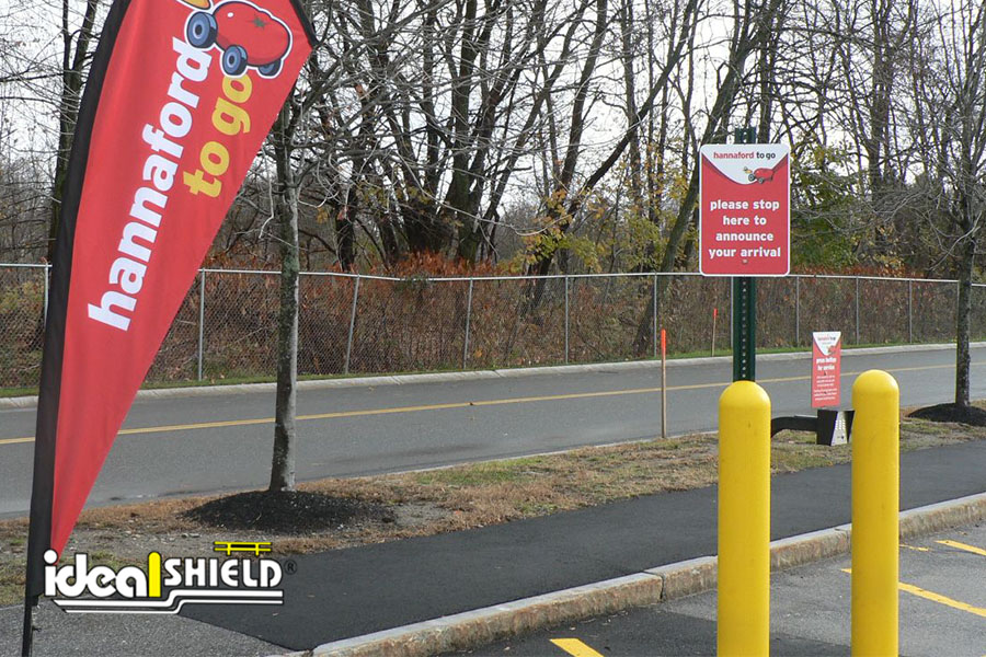 Ideal Shield's Yellow Bollard Sign Systems used for curbside pickup at Hannaford