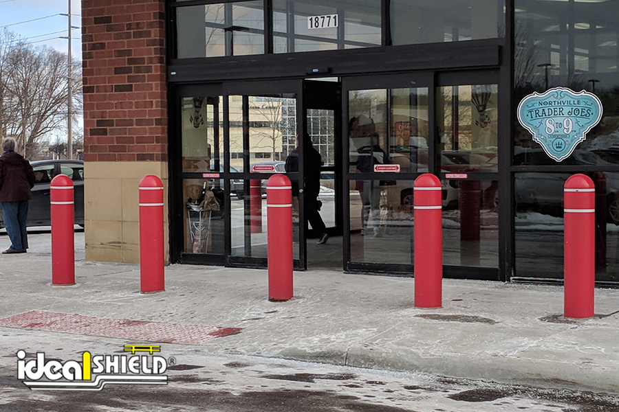 Ideal Shield's red Bollard Covers with reflective tape