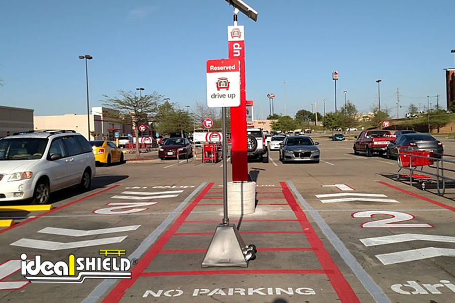 Ideal Shield's Gray Pyramid Sign Bases used for curbside pickup at Target
