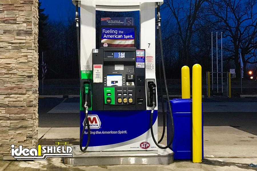 """Ideal Shield's 1/8"""" Bollard Covers at Marathon gas station protecting gas pump from vehicles and car doors"""