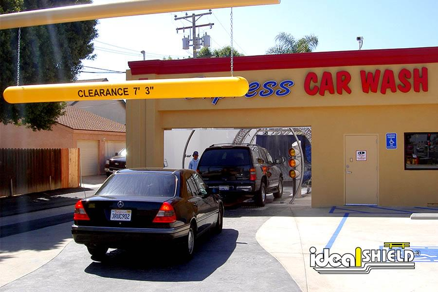 Ideal Shield's yellow plastic Clearance Bar at a car wash entrance