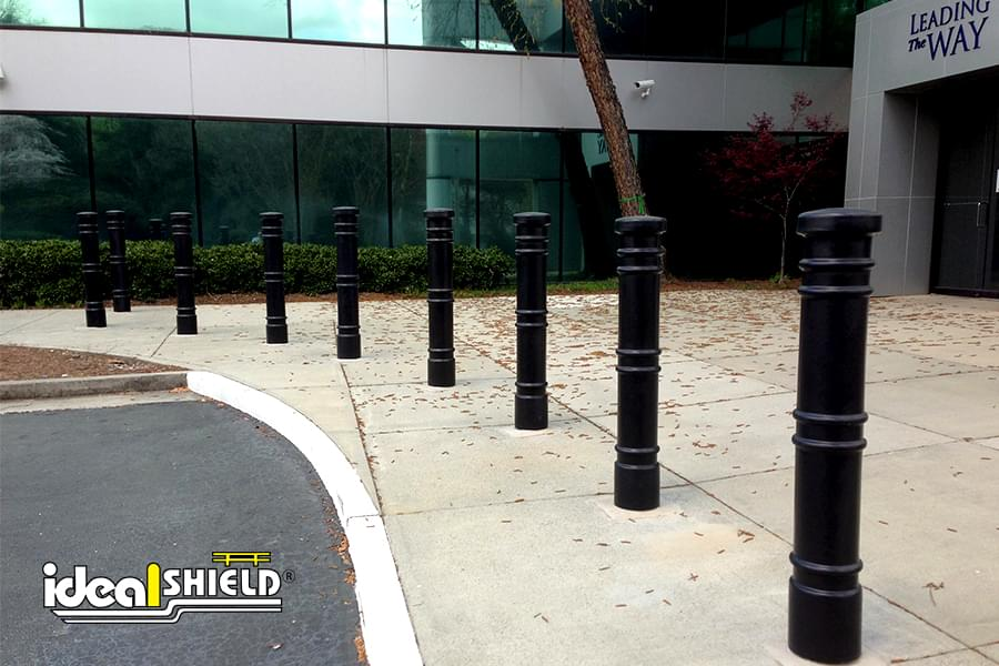 """Ideal Shield's 6"""" Metro Decorative Bollard Covers lining a storefront"""