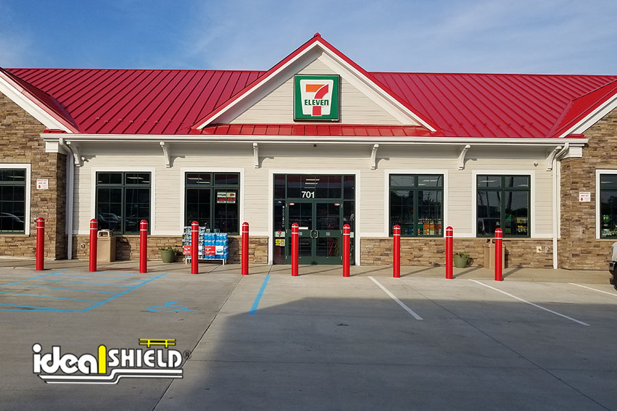 Ideal Shield's Red Bollard Covers with white reflective tape at 711