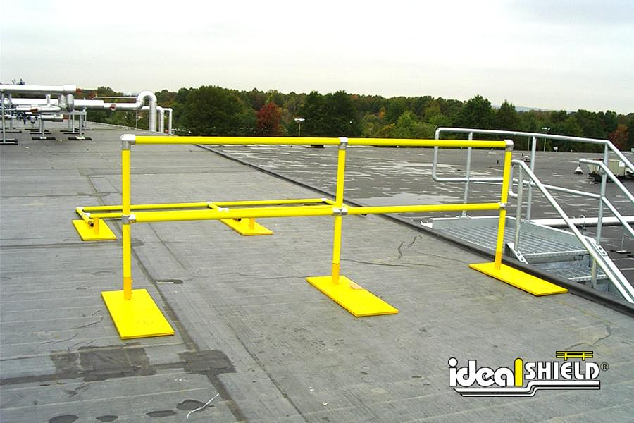 Ideal Shield's pipe & plastic roof fall protection railing with base plates