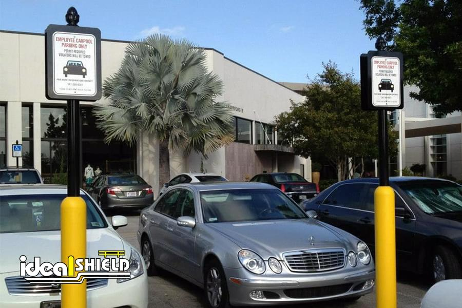 Ideal Shield's Yellow Bollard Sign Systems used for reserved employee parking