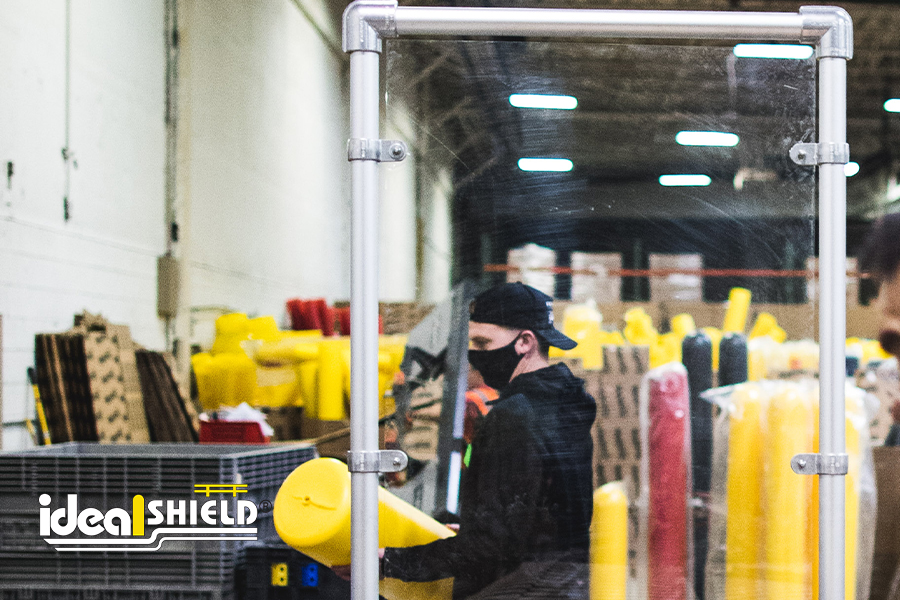 Ideal Shield's Stand Up Sneeze Guard in Aluminum separating shop employees