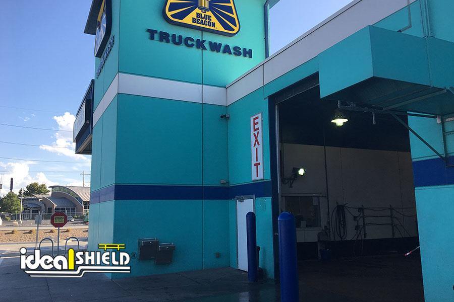 "Ideal Shield's Blue 1/4"" Bollard Covers at a Beacon Truck Wash"
