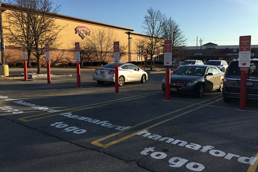 Ideal Shield's Red Bollard Sign Systems used for curbside pickup at Hannaford