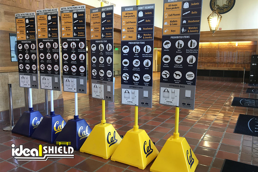Ideal Shield's Blue and Yellow Pyramid Sign Bases with custom decals used for stadium entrance instructions at Cal