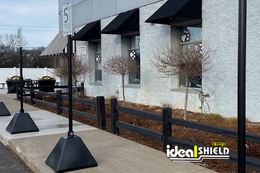 Ideal Shield's Black Pyramid Sign Bases used for curbside pickup at pet store