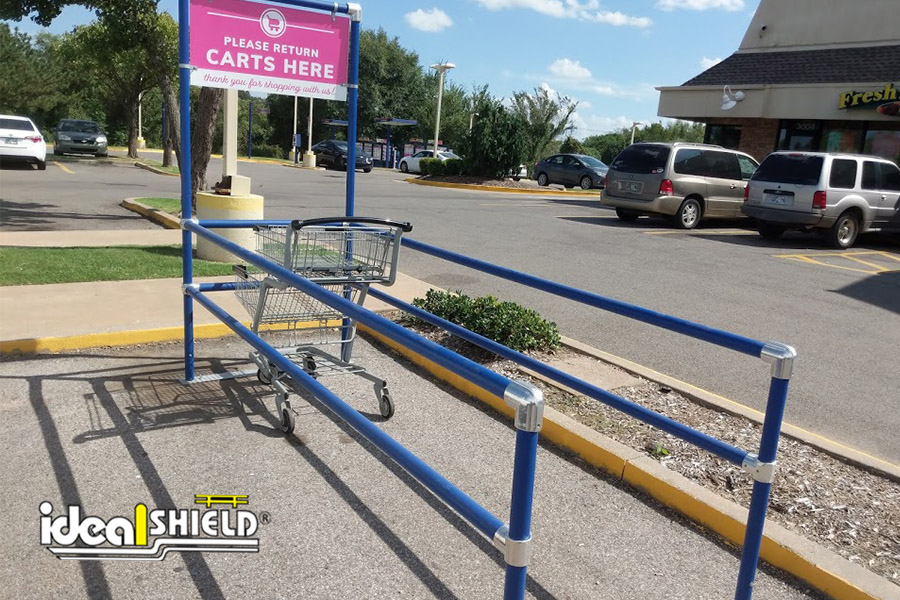 Ideal Shield's blue single Cart Corral for a parking lot