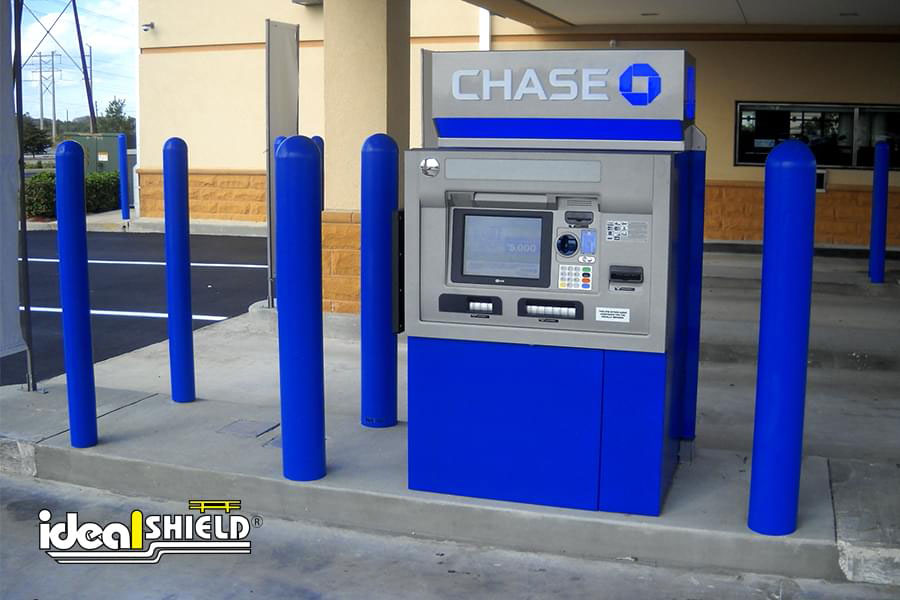 """Ideal Shield's blue 1/4"""" Bollard Covers guarding an ATM at Chase Bank"""