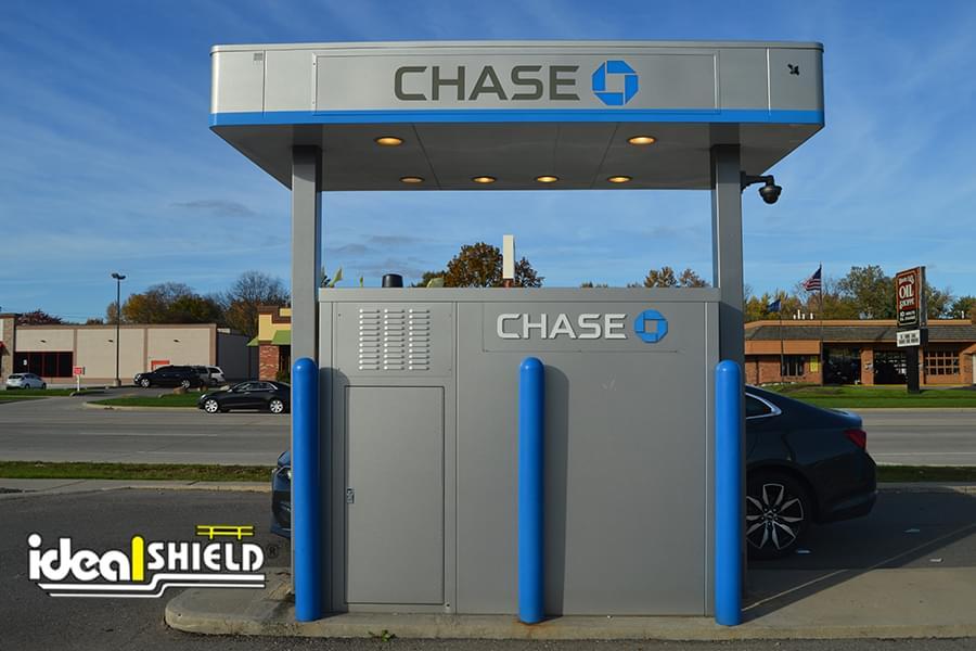 "Custom Blue 4"" Bollard Covers guarding a Chase Bank ATM drive-thru"