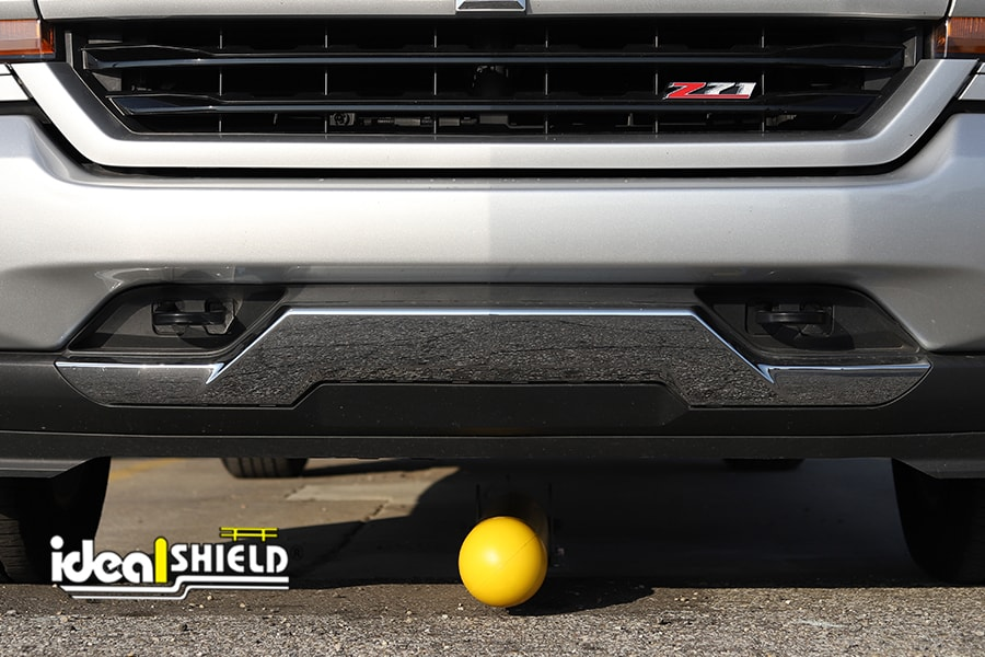 Ideal Shield's Collapsible Locking Bollard grounded, lying underneath a truck