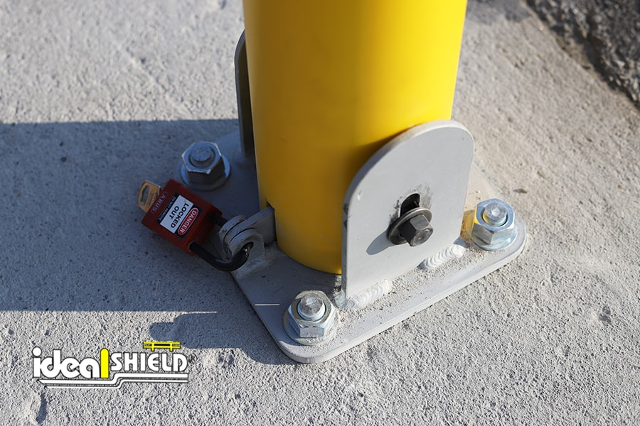Close up of Ideal Shield's Collapsible Locking Bollard locking mechanism and base plate