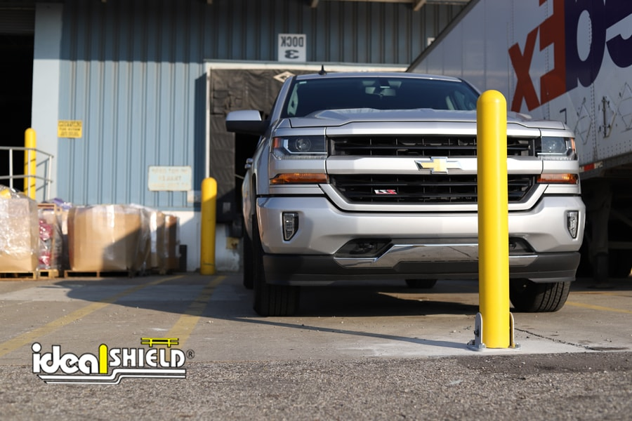 Ideal Shield's Collapsible Locking Bollard in front of a truck