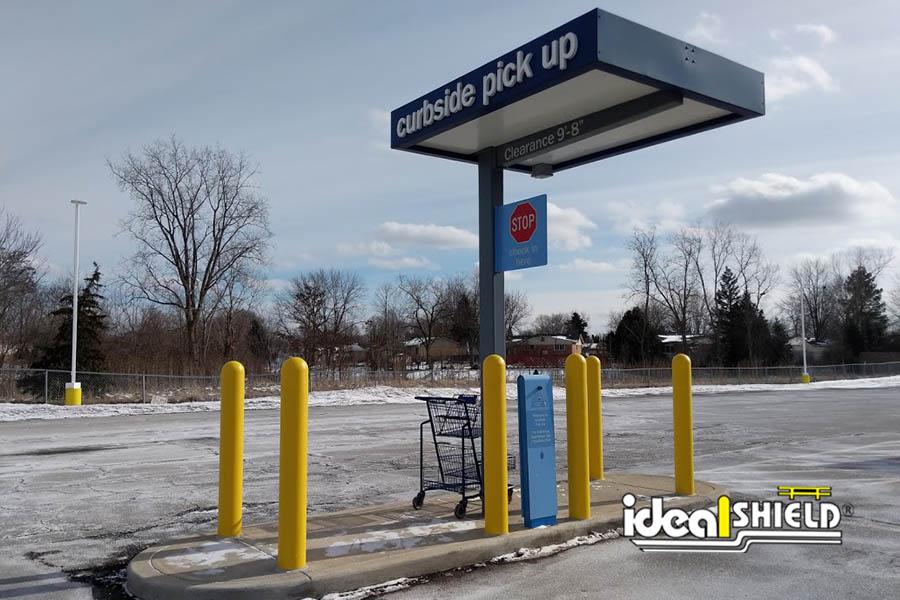 "Ideal Shield's Yellow 1/4"" Bollard Covers at Meijer's curbside pickup kiosk"