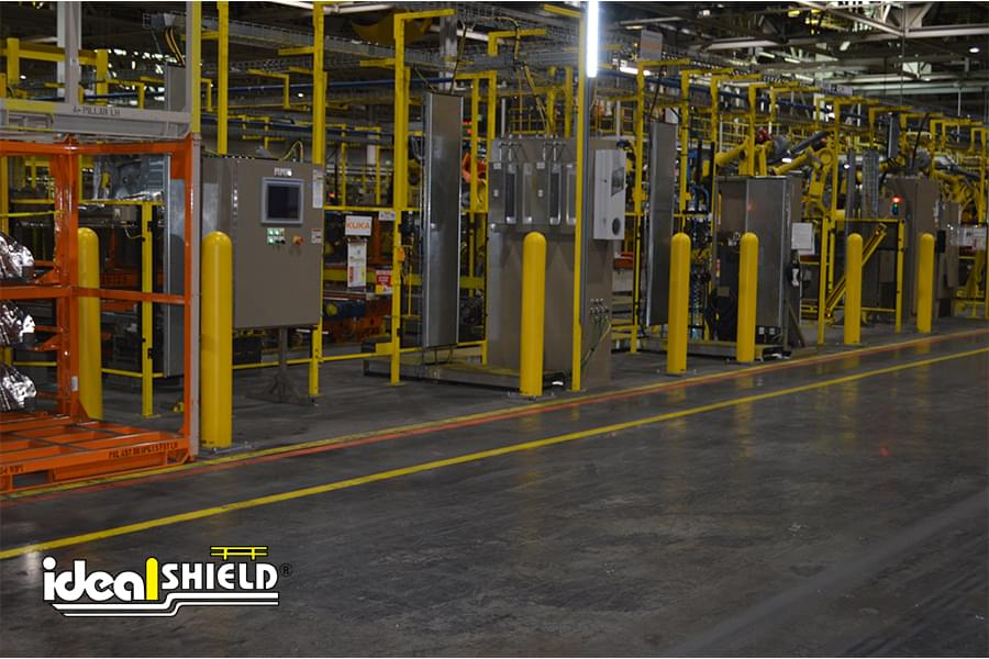 """Ideal Shield's 1/8"""" Yellow Bollard Cover in a Manufacturing Shop"""