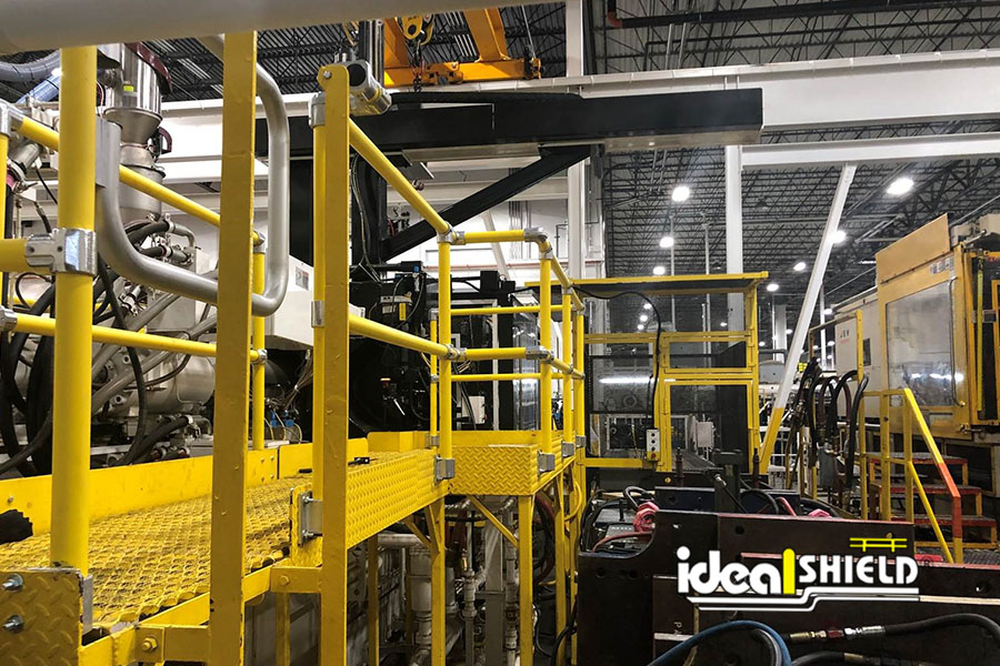 Ideal Shield's Steel Pipe & Plastic Handrail throughout an automotive facility