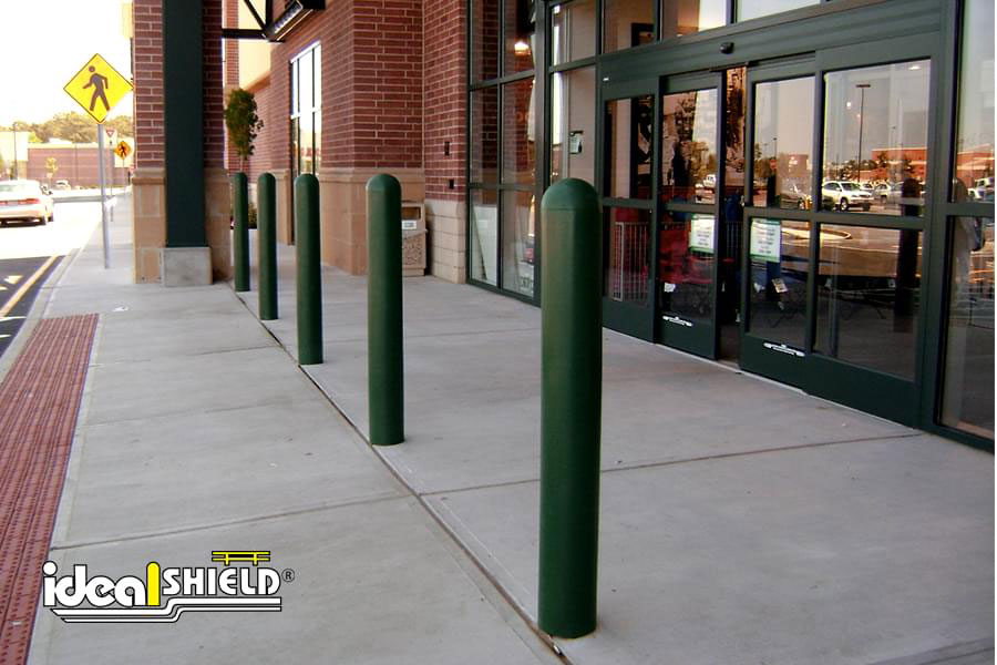 "Ideal Shield's Custom Green 1/4"" Bollard Cover guarding Dick Sporting Good's storefront"