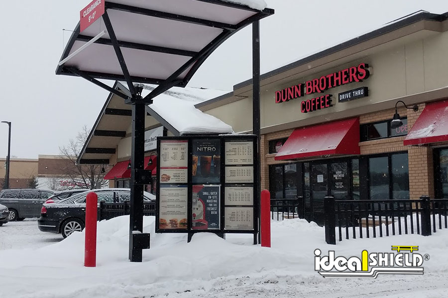 """Ideal Shield's Red 1/4"""" Bollard Covers used for drive-thru kiosk protection"""