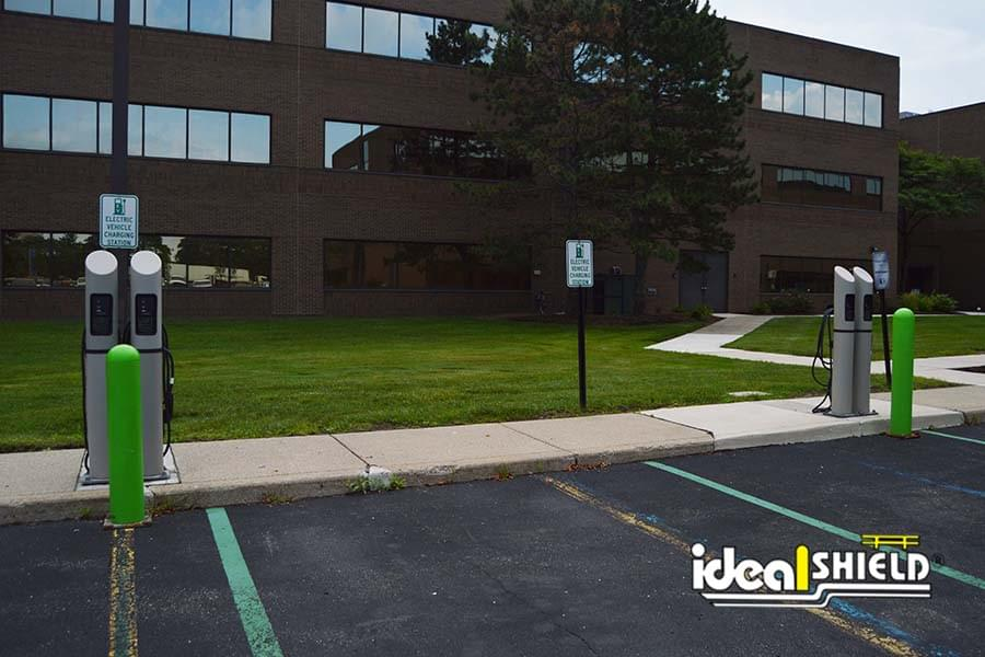 Ideal Shield's custom green post sleeves  protecting Electric Vehicle Charging Stations
