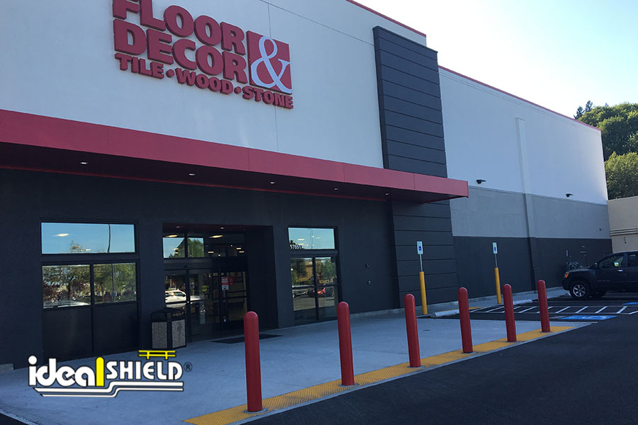 Ideal Shield's Bollard Covers lining the storefront of Floor & Decor