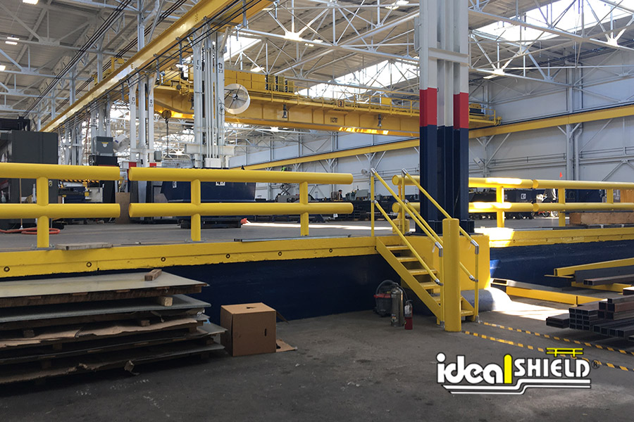 Ideal Shield;s Industrial Guardrail lining a loading zone and Handrail lining the stairs