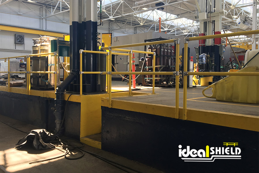 Ideal Shield's Steel Pipe & Plastic Handrail lining a fall area in a warehouse