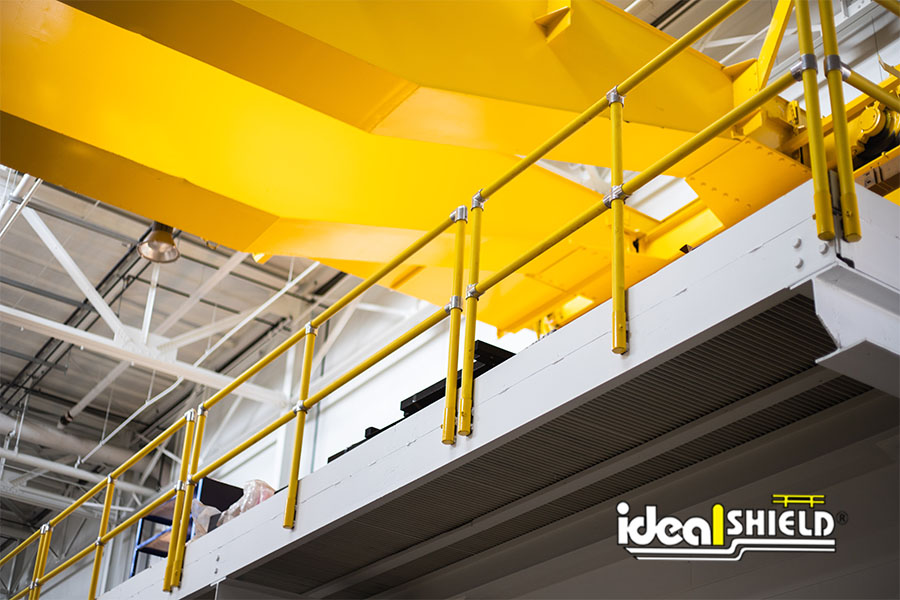 Ideal Shield's yellow side mounted Steel Pipe & Plastic handrail used for fall protection