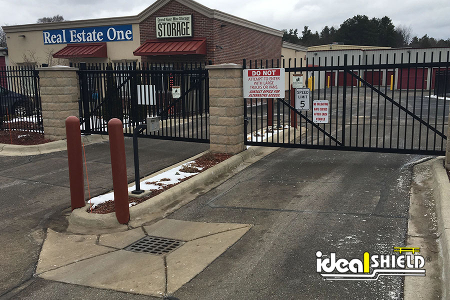 """Ideal Shield's Brown 1/4"""" Bollard Covers used for entrance gate protection"""