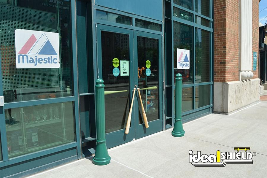 Ideal Shield's Green Paramount Decorative Bollard Covers Protecting a Storefront