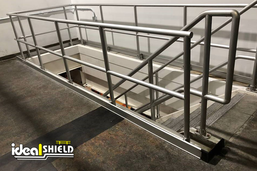 Ideal Shield's Aluminum Handrail around and down a flight of stairs