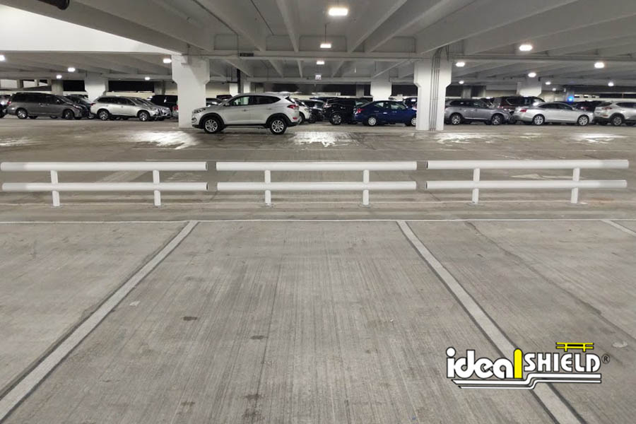 Ideal Shield's Two-Line Heavy-Duty Guardrail sleeved in white plastic for a parking garage