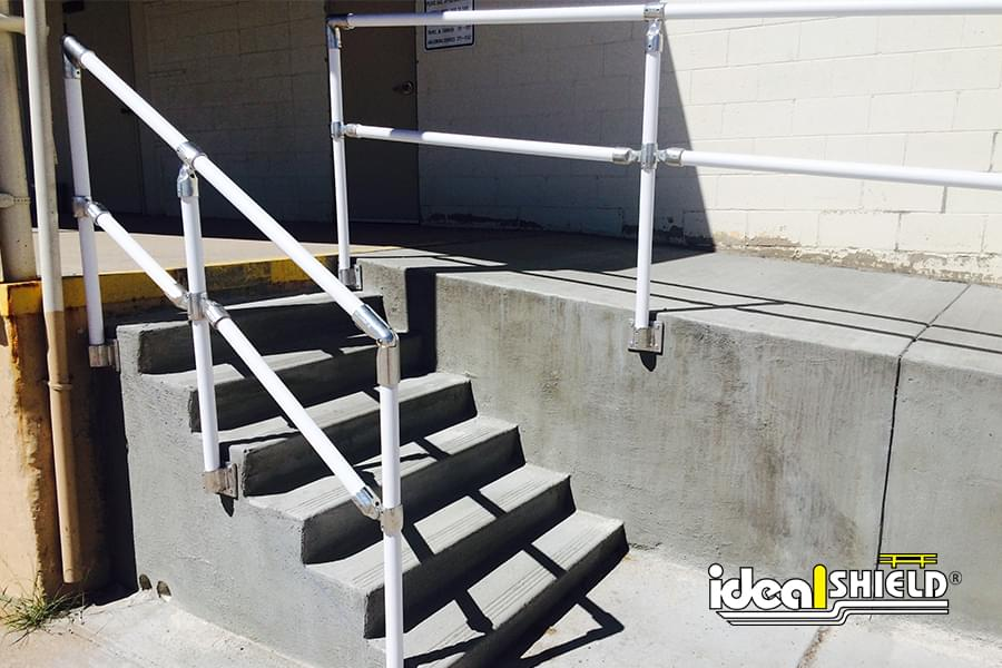Ideal Shield's White Steel Pipe and Plastic Handrail on Stairs