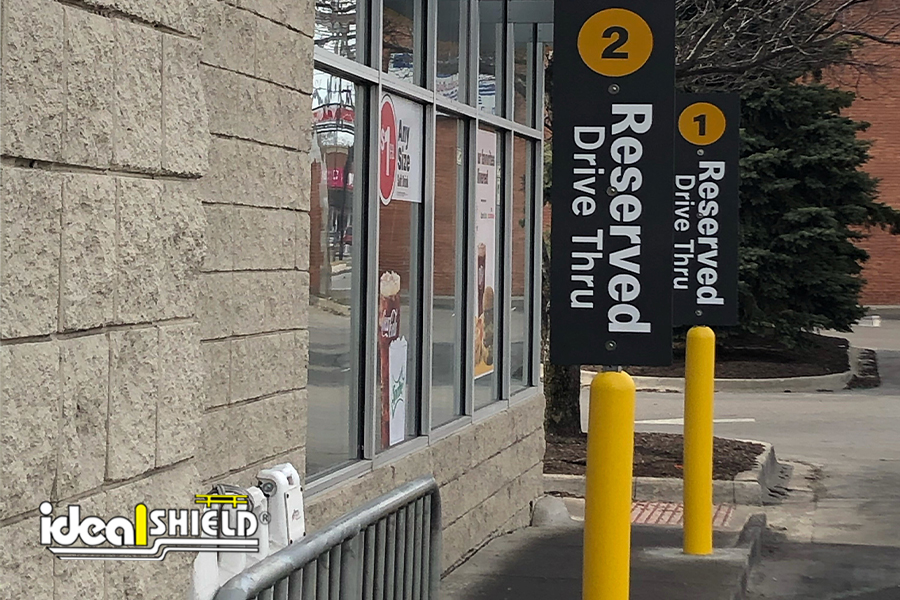 """Ideal Shield's 4"""" Bollard Sign Systems for McDonald's Curbside Pickup"""