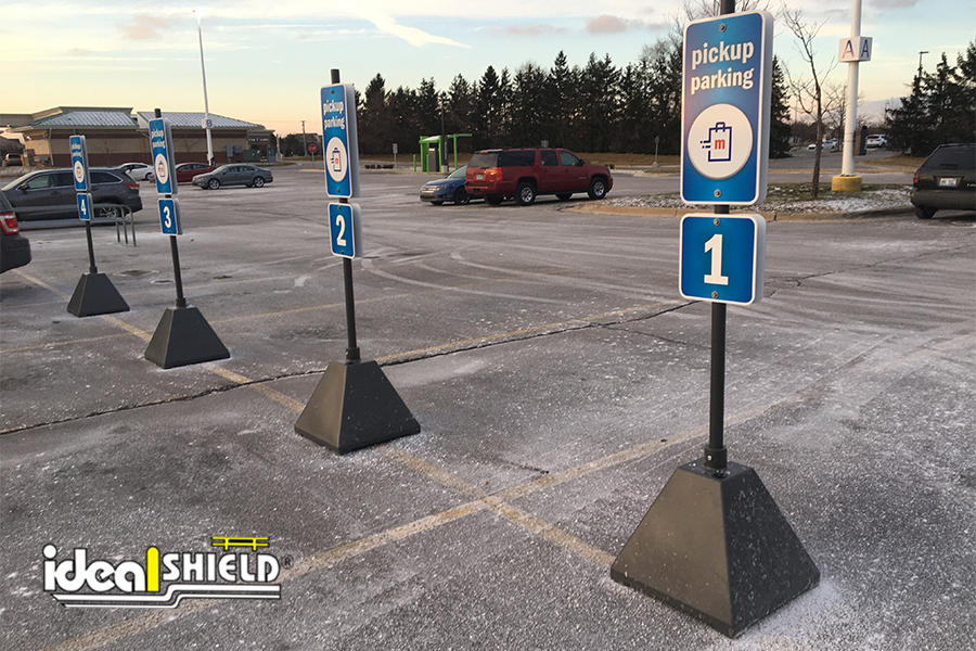Ideal Shield's Gray Pyramid Sign Bases used for curbside pickup at Meijer