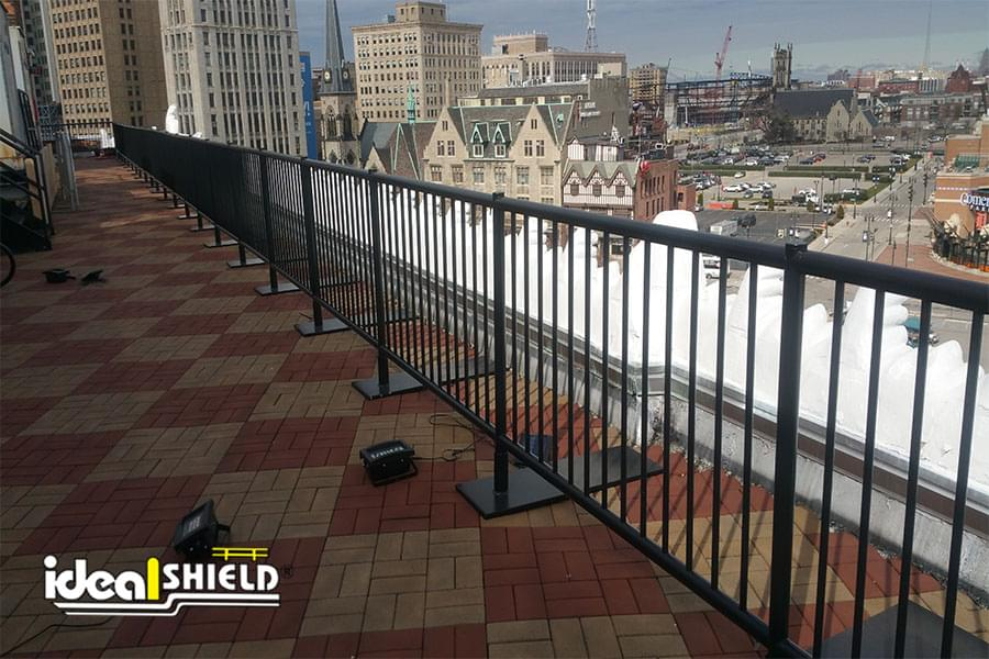 Ideal Shield's black Roof Top Fall Protection Safety Railing with footings at the Detroit Opera House