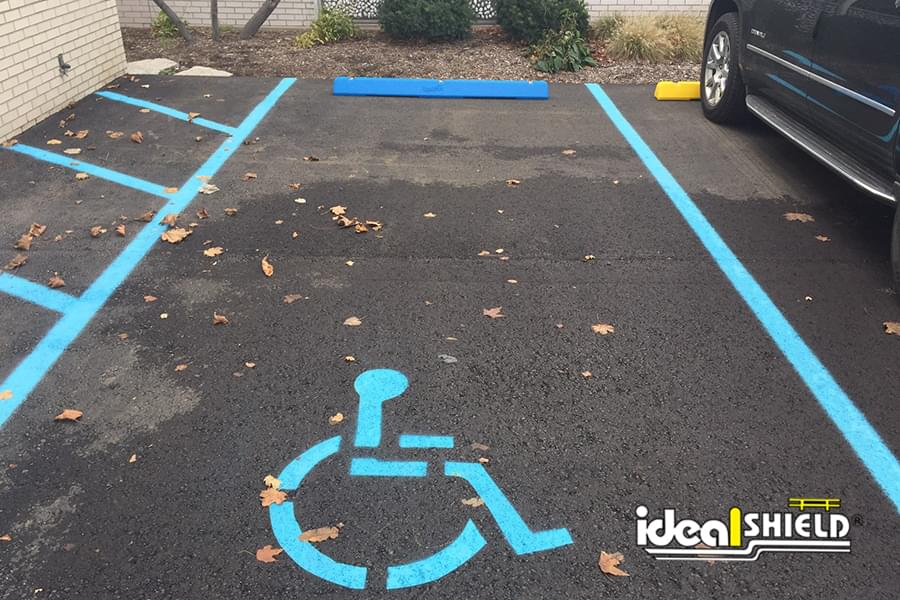 Ideal Shield's blue plastic Parking Block used for a handicap accessible parking spot