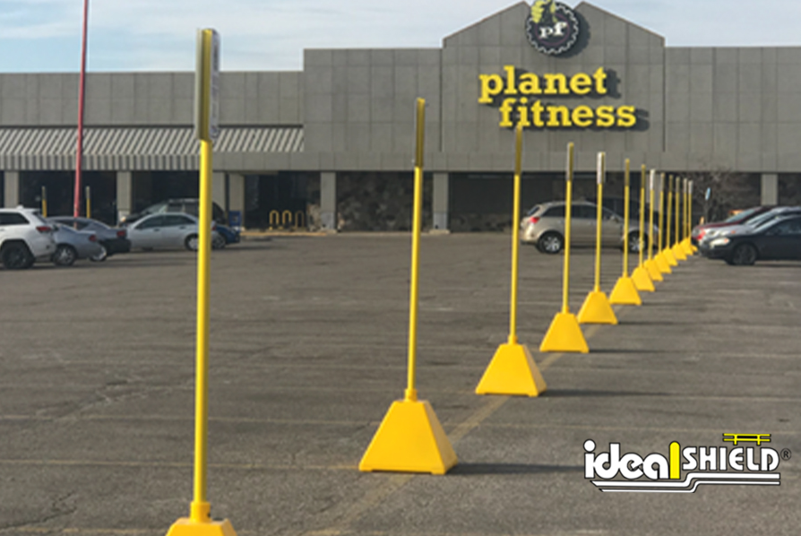 Ideal Shield's Yellow Pyramid Sign Bases at Planet Fitness