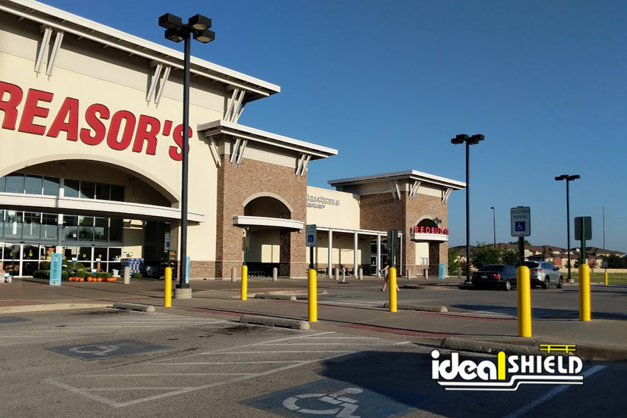 Ideal Shield's yellow Bollard Sign Systems used for handicap accessible parking spots at Reasor's grocery store