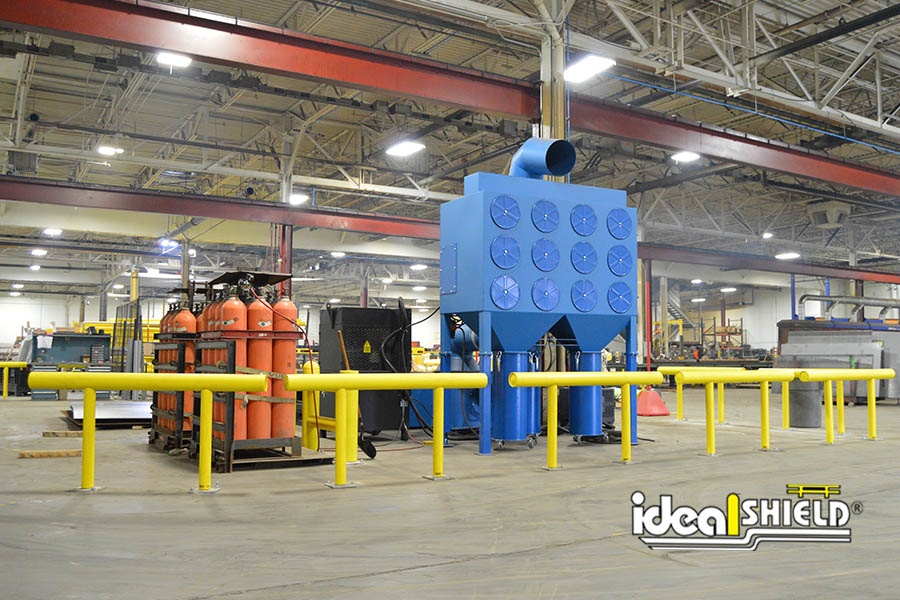 Ideal Shield's One-Line Yellow Standard Guardrail protecting large machinery