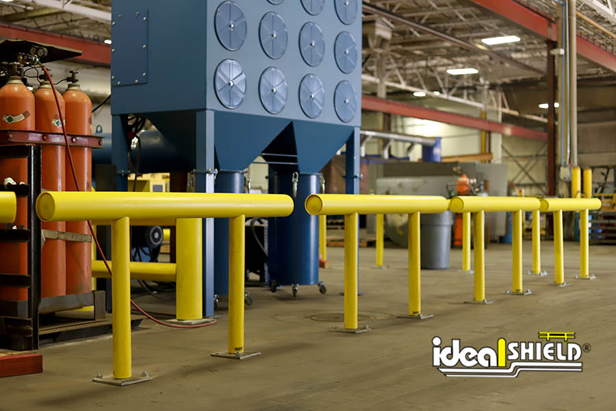 Ideal Shield's One Line Yellow Standard Guardrail guarding machinery from forklift traffic