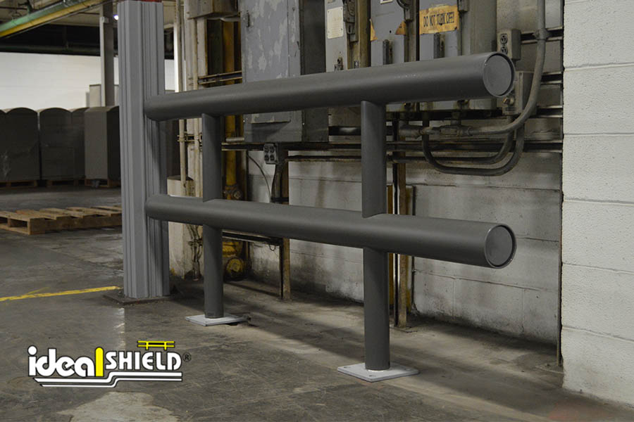 Ideal Shield's Two-Line Standard Guardrail sleeved in gunmetal gray plastic guarding electrical boxes