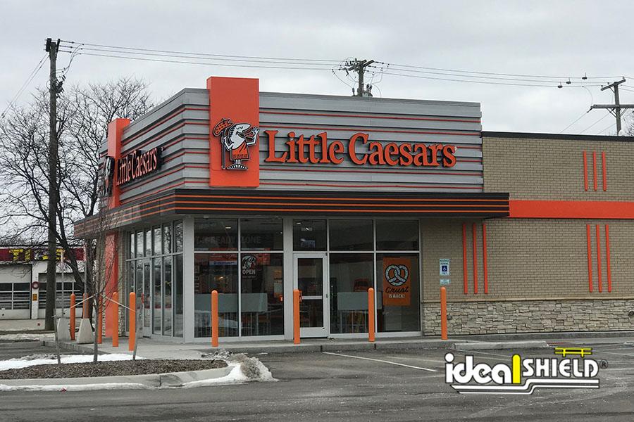 "Ideal Shield's Orange 1/4"" Bollard Covers at Little Caesars"