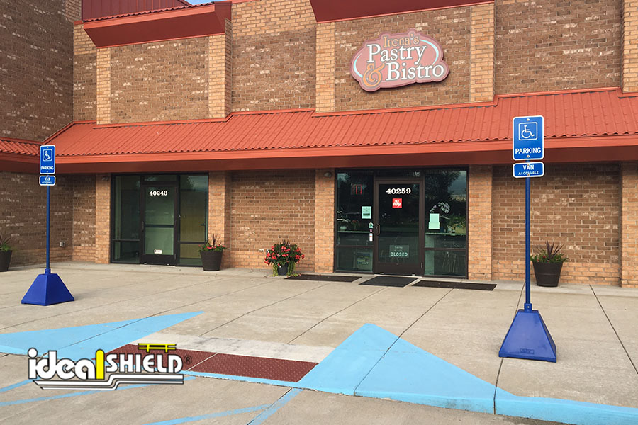 Ideal Shield's blue Pyramid Sign Bases used for handicap parking signage