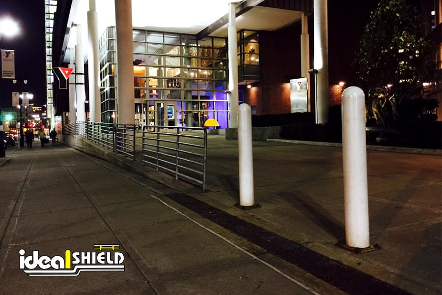 """Ideal Shield's White 1/4"""" Bollard Covers at the YMCA in Downtown Detroit"""