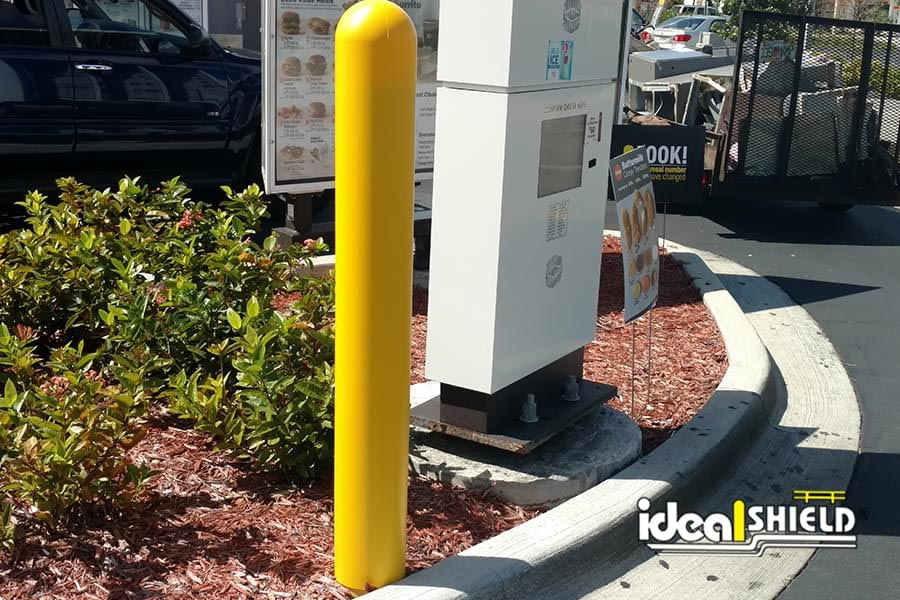 """Ideal Shield 1/8"""" yellow post cover at fast food drive through"""